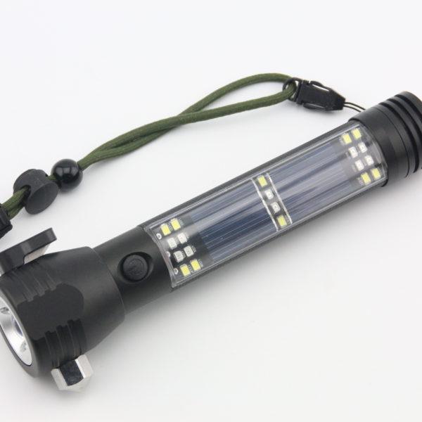 Solar powered emergency flashlight seatbelt cutter compass